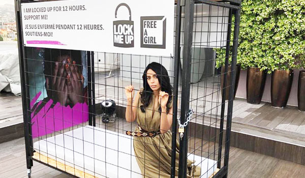 Mallika-Sherawat-locks-herself-in-a-cage
