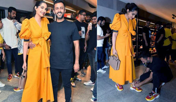 Anand-Ahuja-gets-down-on-his-knees-to-tie-Sonam-Kapoors-shoelace