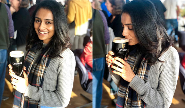 Pragathi-drinks-beer-for-photo